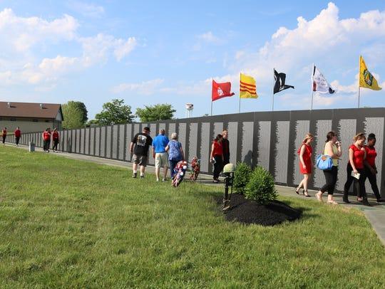 Veterans and other community members visiti the Vietnam