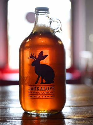 A growler rest on the bar at Jackalope Brewing Company Wednesday May 11, 2016, in Nashville, Tenn.