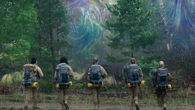 "Scientists and soldiers Gina Rodriguez (from left), Tessa Thompson, Tuva Novotny, Natalie Portman and Jennifer Jason Leigh step into The Shimmer in ""Annihilation."""