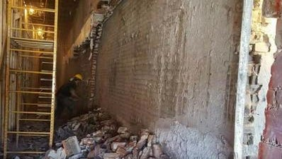 A photo posted on Hultgren Construction's Facebook page on Nov. 30 appears to show a worker removing bricks from a load-bearing wall that separate PAve from the former Copper Lounge building at 136 S. Phillips Ave.