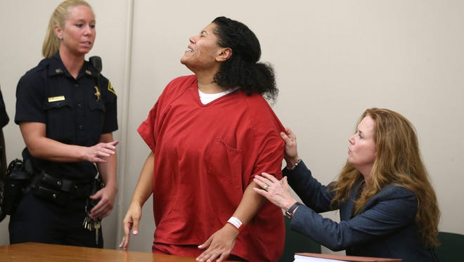 Rochester City Court Judge Leticia Astacio stands Thursday and cries out to her daughter after her daughter's outburst at Judge Stephen Aronson after Astacio received a 60-day sentence for violating the terms of her 2016 drunk driving conviction. At right is her defense attorney Bridget Field.