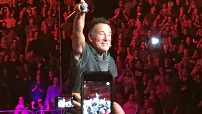 Bruce Springsteen wades into the crowd during Monday night's show at the Xcel Energy Center in St. Paul.