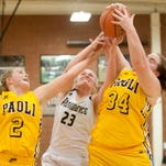 Paoli Lady Rams guard Isabela Brewster, left, and Lady Rams center Rachel Cadle, right, fight for a rebound with Providence Lady Pioneers forward Claire Rauck, center. 05 February, 2016