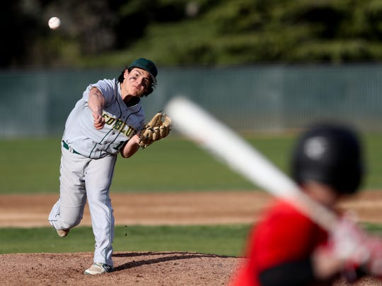 Red Bluff pitcher Fabian Chavez fires the ball to the plate during a doubleheader against Foothill on Monday at Shasta College.