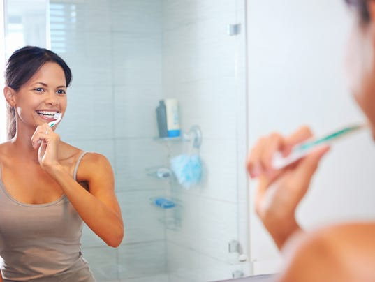 636553252295917011-woman-brushing-teeth.jpg