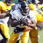 Pittsburgh Steelers running back Le'Veon Bell (26) carries the ball during training camp drills.