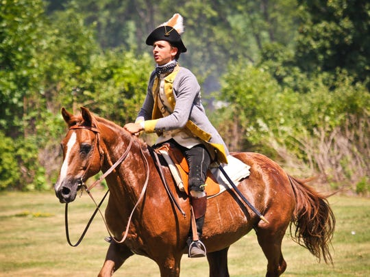 A military re-enactor astride a horse at Fort Ticonderoga.