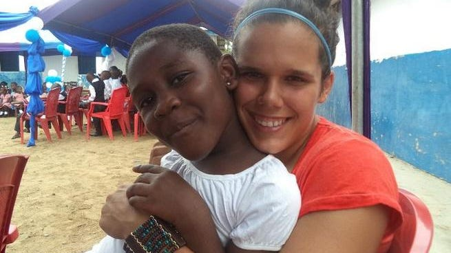 Jamie Lee Sonnenberg-Smith, a recent Georgian Court University graduate, poses for a picture with one of her students in Ghana, where she worked to end child labor.