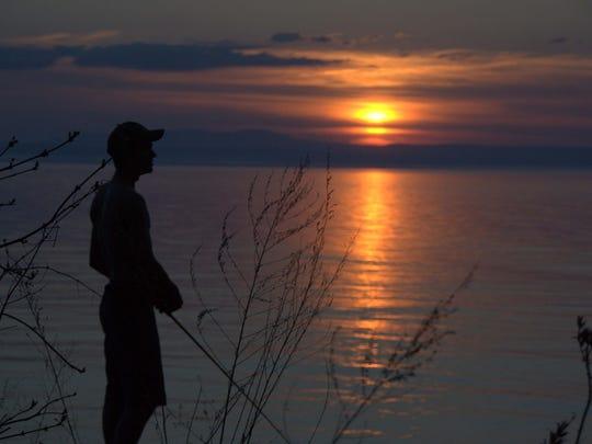 Fishing at dusk with Ian Brett at Charlie's Boathouse in Burlington.