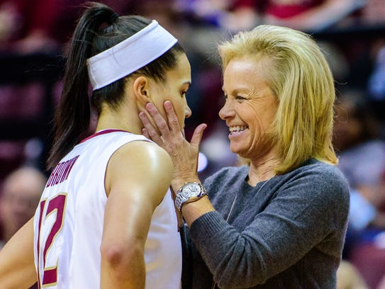 Brittany Brown (12) is given praise by Sue Semrau,