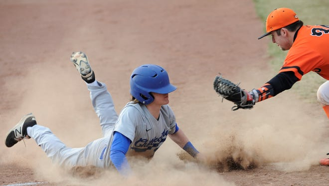 Chillicothe's Zach Coats slides safely into third base during Monday's 6-5 loss to Waverly.