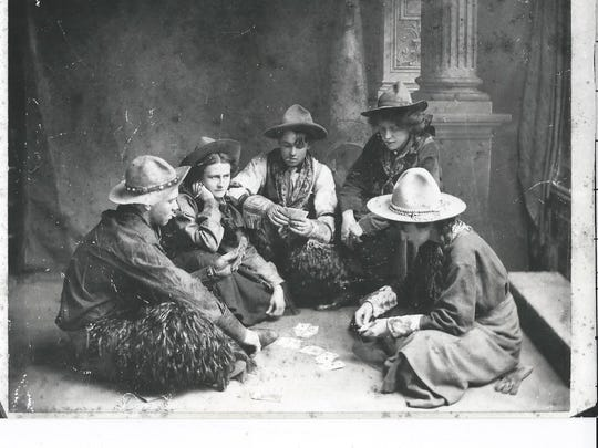 """Maxwell """"Freckles"""" Atkinson, far left, plays cards with a group of women in this vintage photo."""