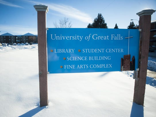 A sign stands on a snowy hillside on the University