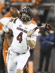 South Carolina quarterback Jake Bentley (4) gets off