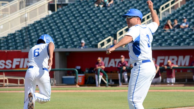 Carlsbad coach Cody May gives Trey Castaneda the green light to score from third base against Valley in Thursday's 6A state quarterfinals at Isotopes Park in Albuquerque.