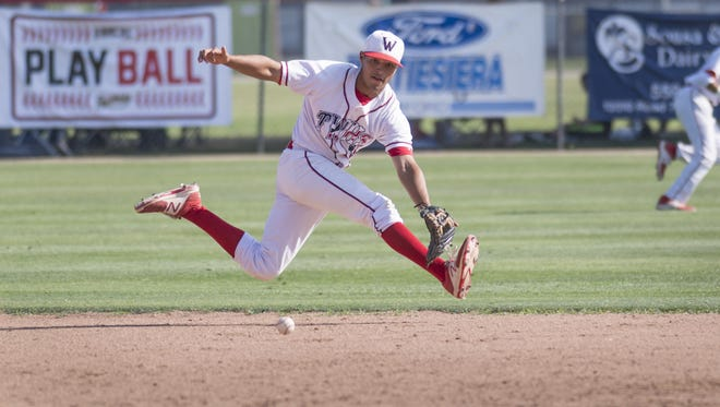 Tulare Western's Hector Ruvalcaba chases a hit ball from Tulare Union's Asher Gallegos in a East Yosemite high school baseball game on Thursday, May 11, 2017.