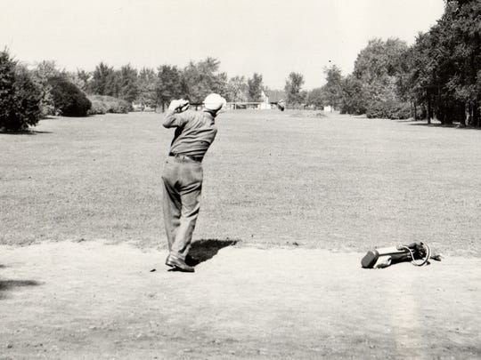 A golfer plays a hole  in Detroit's Chandler Park in 1947.
