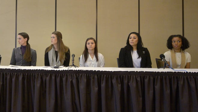 Larry Nassar victims Rachael Denhollander, center left, Sterling Riethman, Kaylee Lorincz, Geanette Antolin, and Tiffany Thomas Lopez talk to the press after the former MSU doctor's sentencing in the child porn case. He still faces sentencing in the sex assault cases.
