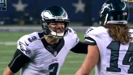 Mark Sanchez yells at Riley Cooper during the Eagles' 33-10 win over Dallas on Nov. 27.