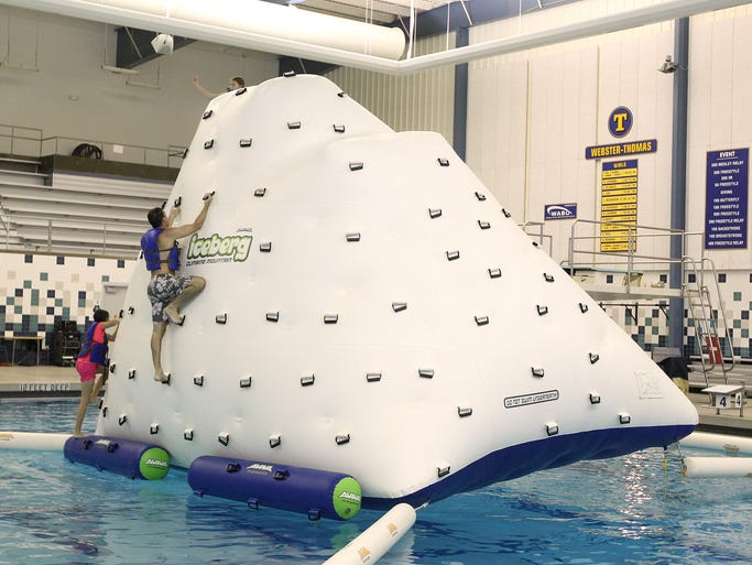 A giant inflatable iceberg was set up in the deep end of the Webster Aquatic Center .