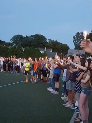 Friends of Owen Thomas gathered at Brighton High School for a candlelight vigil