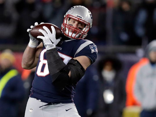 FILE - In this Jan. 13, 2018, file photo, New England Patriots tight end Rob Gronkowski, right, catches a pass during the second half of an NFL divisional playoff football game against the Tennessee Titans in Foxborough, Mass. Gronkowski says he expects to play in Sunday's Super Bowl against the Philadelphia Eagles. (AP Photo/Charles Krupa, File)