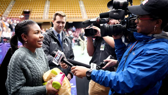 Asheville local Kennedi Green, 14, talks to the media