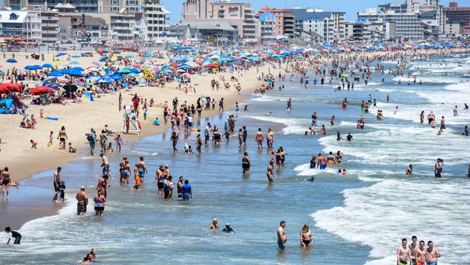 The beach at Ocean City was crowded with children and adults playing in the waves on Monday.