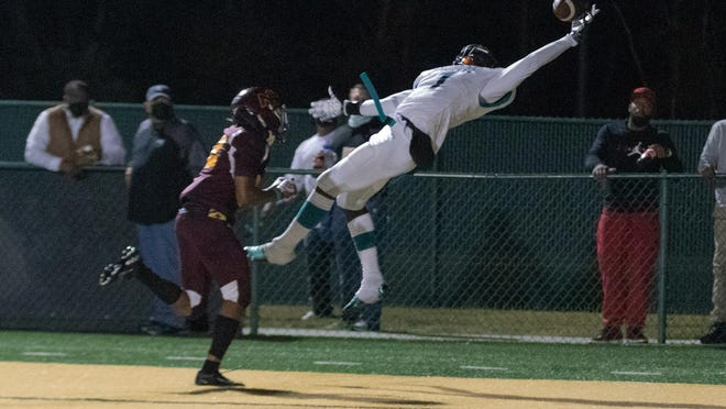 Islands High School's John Dickerson IV makes a one-handed catch for a 12-yard touchdown against New Hampstead on Friday night at Pooler Stadium.