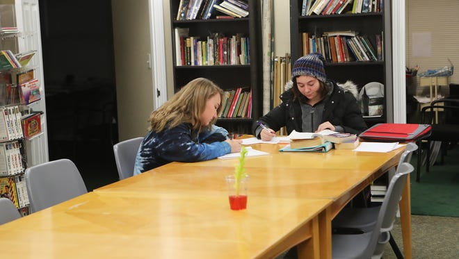 Jane Dalrymple, left, and Rebecca Sharrow do schoolwork at Northern Summit Academy Wednesday in Anderson.
