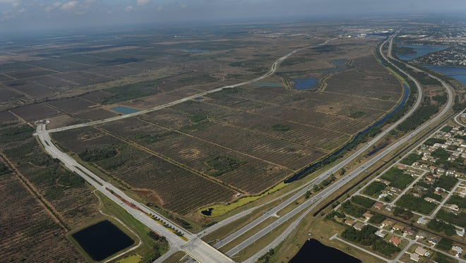 Aerial looking northwest of the Southern Grove property in Tradition, Port St. Lucie, Village Parkway and Becker Road and Interstate 95.