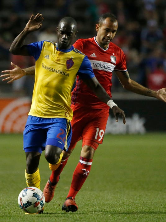 Colorado Rapids midfielder Micheal Azira (22) controls the ball past Chicago Fire midfielder Juninho during the second half of an MLS soccer match Wednesday, May 17, 2017, in Bridgeview, Ill. The Fire won 3-0. (AP Photo/Nam Y. Huh)