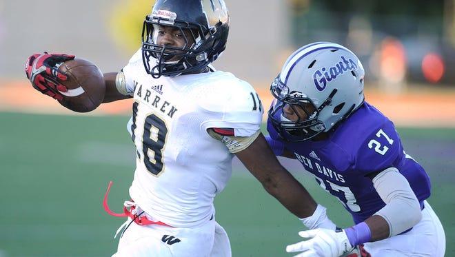 Mykelti Williams of Warren Central runs for a touchdown in the first quarter. Ben Davis hosted Warren Central in high school football Friday September 13, 2013. Rob Goebel/The Star.