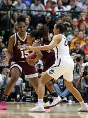 Mar 31, 2017; Dallas, TX, USA; Connecticut Huskies guard/forward Napheesa Collier (24) defends against Mississippi State Lady Bulldogs forward Breanna Richardson (3) in the fourth quarter in the semifinals of the women's Final Four at American Airlines Center. Mandatory Credit: Matthew Emmons-USA TODAY Sports