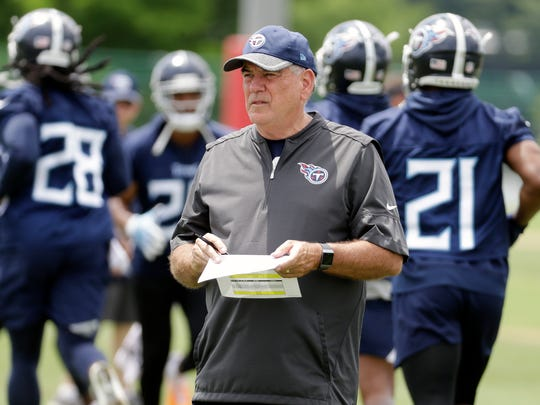 Tennessee Titans defensive coordinator Dean Pees watches players during an organized team activity at the Titans' NFL football training facility Wednesday, May 30, 2018.