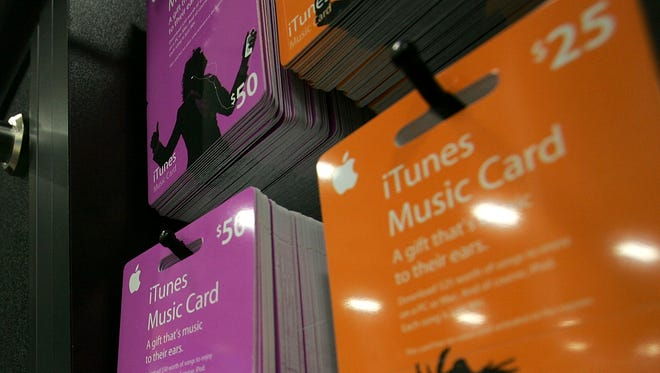 iTunes song gift cards are seen on display at a Best Buy store.