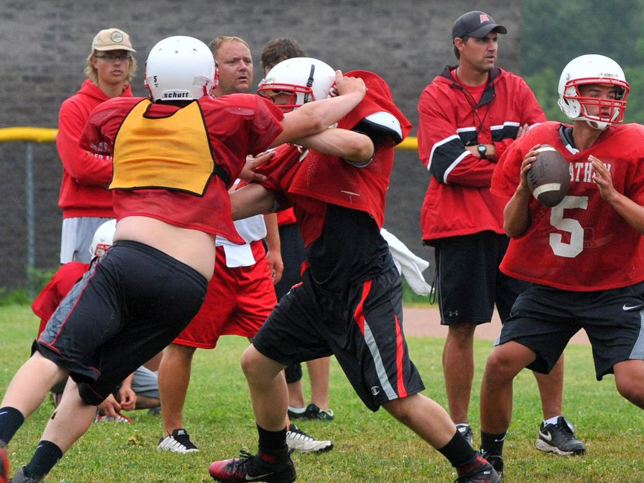 Members of the Marathon football team go through a drill during practice late last week.