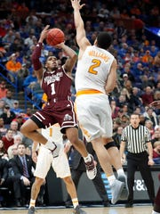 Mississippi State's Lamar Peters (1) shoots as Tennessee's
