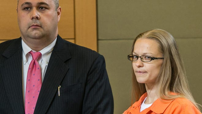 Angelika Graswald, right, stands in court with Michael Archer a forensic scientist, as her attorneys ask for bail and to unseal the indictment against her during a hearing Wednesday, May 13, 2015, in Goshen, N.Y.