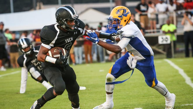 Sussex Tech senior running back Isaiah Brown stiff-arms A.I.  du Pont's Jamir Dantley during the first quarter of the DFRC Kickoff Classic at Sussex Tech Thursday.