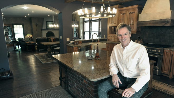 In this May 19, 2016 photo, Don Wesely sits in the kitchen of his Havelock home in Lincoln, Neb. When the 'Extreme Makeover' episode aired in January 2007, millions of viewers watched Ty Pennington and his crew converge on 6825 Platte Ave. in Lincoln to surprise a couple with a new home. Now, 10 years later, the dream home has been sold off.
