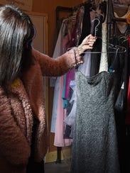 Barbie Marcoe shows a prom dress inside the trailer