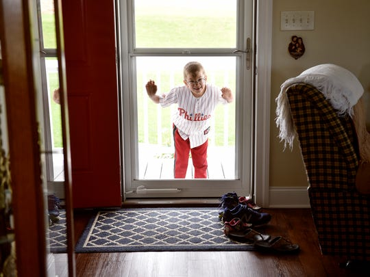 """Sean Kisielnicki, 7, looks for his """"buddy people"""" while playing after dinner at his Hopewell Township house Wednesday, June 7, 2017."""