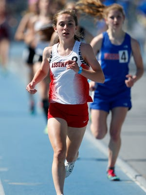 Assumption's Julia Schumacher leads the pack Thursday on her way to a win in the girls 3000 meter run at the 2015 State Track Meet in Des Moines.
