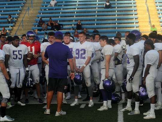 The CLU football team gathers before a practice and