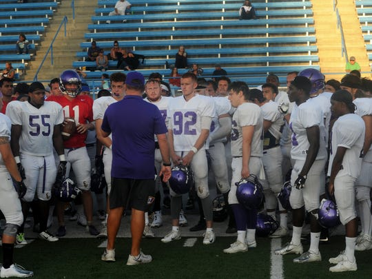 The CLU football team gathers before a practice and scrimmage at Moorpark College in August.
