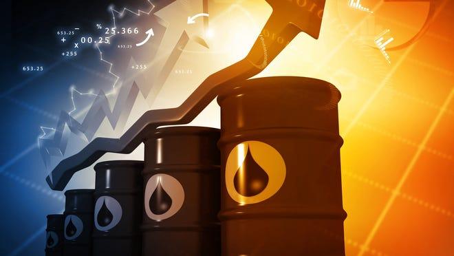 Stock market arrow rising above a stack of oil barrels