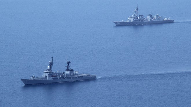 Japanese and Philippine ships take part in a joint naval exercise in the South China sea.