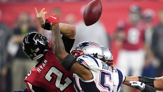 Falcons quarterback Matt Ryan fumbles as he is hit by Patriots linebacker Dont'a Hightower.