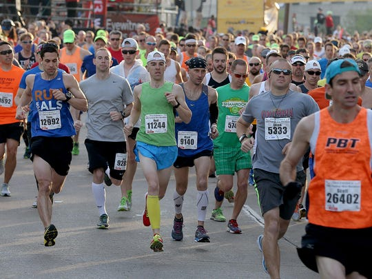 Thousands of runners take off at the start of the OneAmerica 500 Festival Mini-Marathon.
